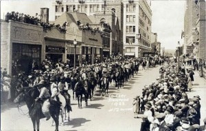Rodeo on Main Street? This 1923 Calgary Stampede parade of mounted cowboys may have been many of that year's contestants. (Photo credit: Calgary Stampede Archives, Wikimedia Commons)
