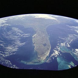 This1998  image from space shows a Florida surrounded by blue waters. Pollution may darken that seascape image soon. (Photo credit: NASA, Wikimedia Commons)