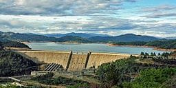 Shasta Dam in 2009. A plan to raise the dam's water level will wipe out Native American land. (Photo credit: Apaliwal, Wikimedia Commons)