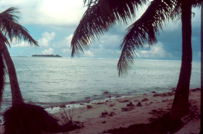 beach with managaha in lagoon
