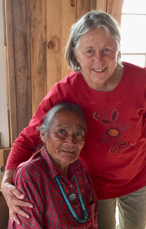 Giving a hug and a book to my friend, Ms. Brown-Yazzie, Chinle, Canyon deChelly, Navajo Nation