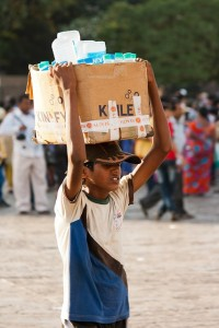 A boy selling water in India. Talk about water pressure!